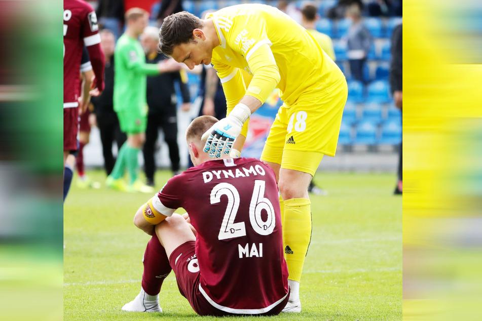 Das war so nicht geplant: Hachings Keeper Jo Coppens (30) musste nach der Partie Dynamo-Kapitän Sebastian Mai (27, am Boden) trösten.