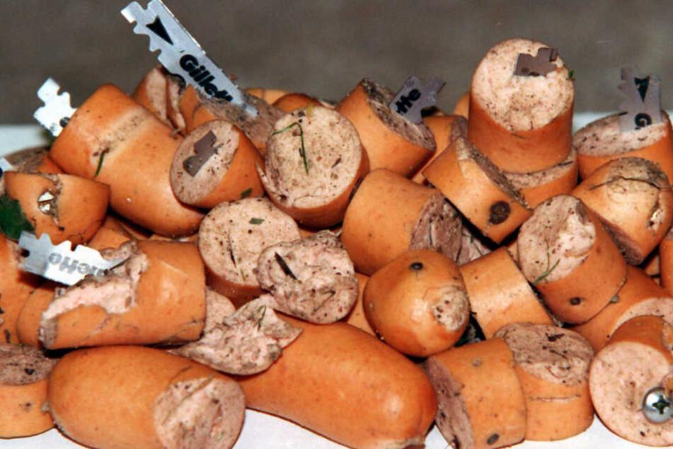 Die 28-Jährige fand mit Rasierklingen und Draht präparierte Würstchen auf ihrem Grundstück. (Symbolbild)