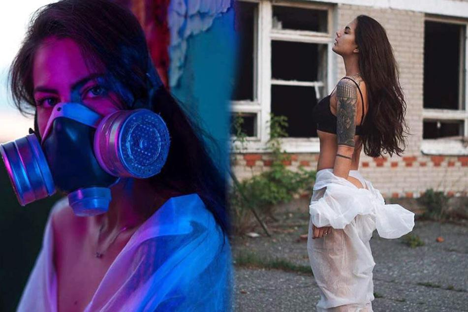 Veronika Rocheva (23) mit Gasmaske und leicht bekleidet vor einer wahren Geisterstadt-kulisse.