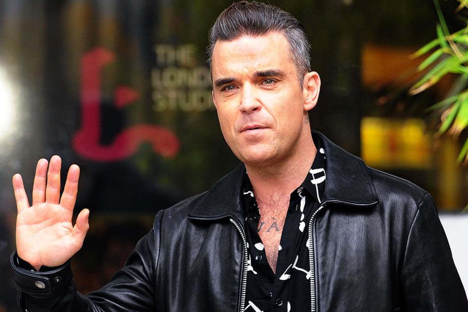 Sänger Robbie Williams wird am Donnerstagnachmittag bei der Eröffnungsfeier auftreten - was in Großbritannien gar nicht gerne gesehen wird.