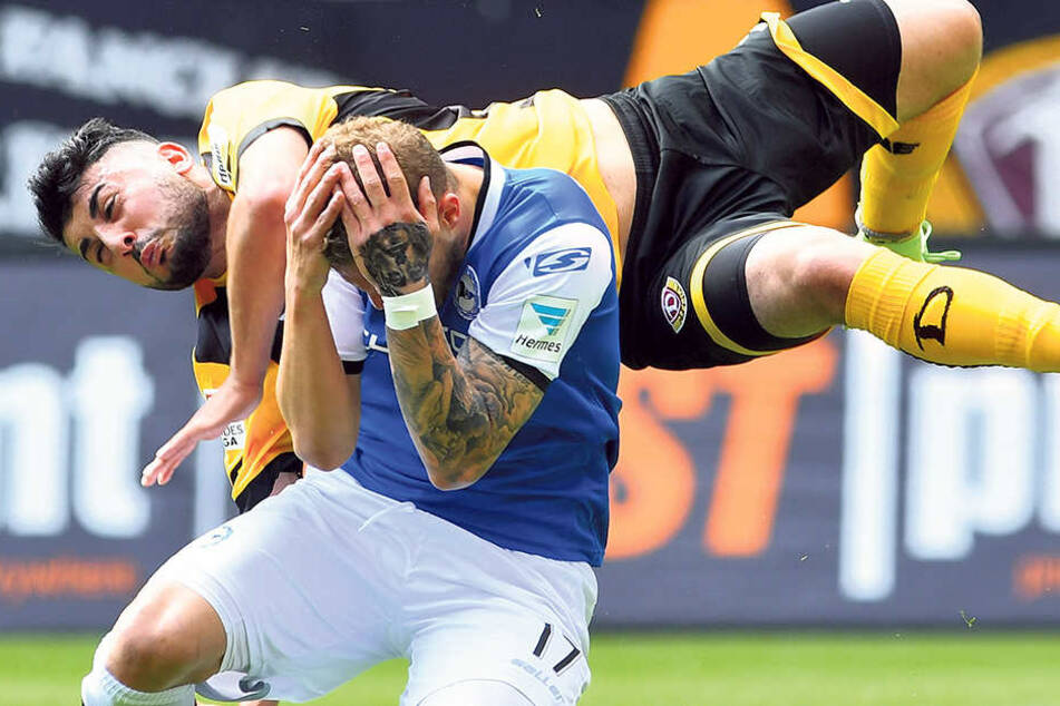 Da liegt er quer in der Luft: Aias Aosman rasselt im Spiel gegenArminia Bielefeld mit Christoph Hemlein zusammen.