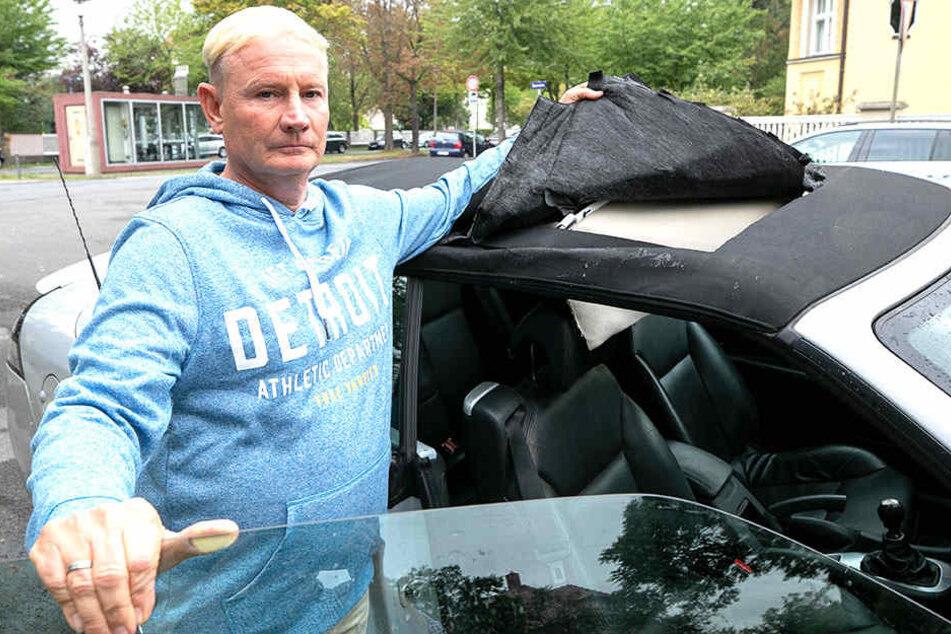 AfD-Mann Heiko Müller (54) ärgert sich über den Anschlag auf seinen neun Jahre alten Saab.