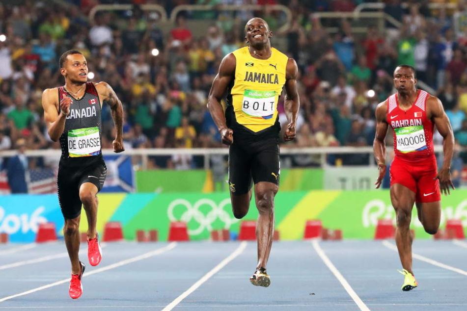 ZweiterAndré De Grasse aus Kanada und Usain Bolt im Zweikampf über die 200 Meter.