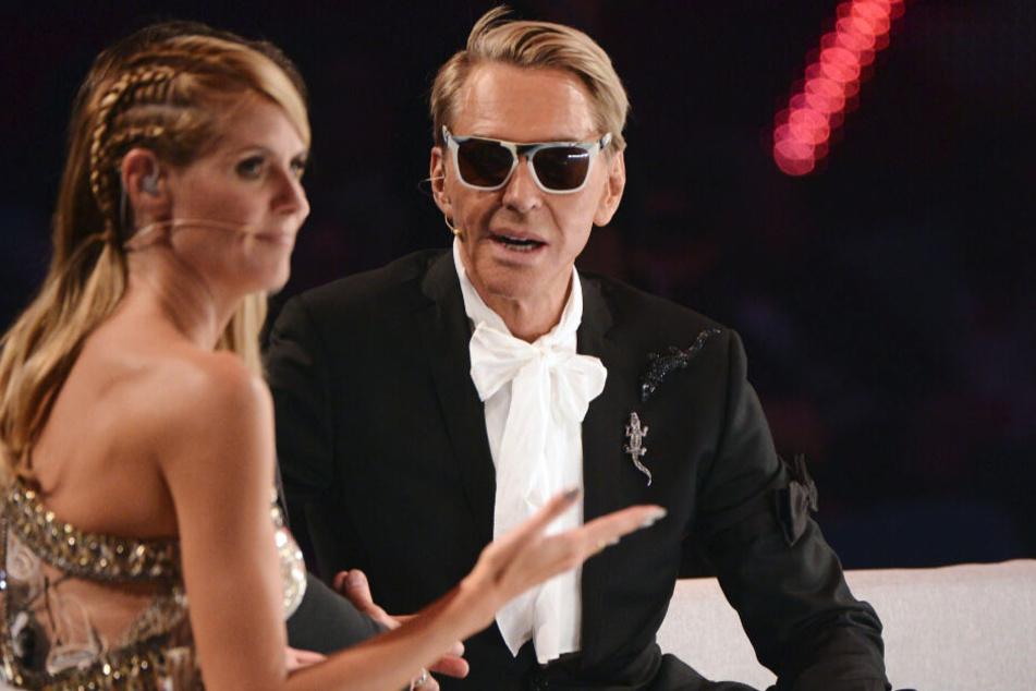 """2014 sitzt Wolfgang Joop neben Heidi Klum beim Finale der Fernsehshow """"Germany's next Topmodel""""."""