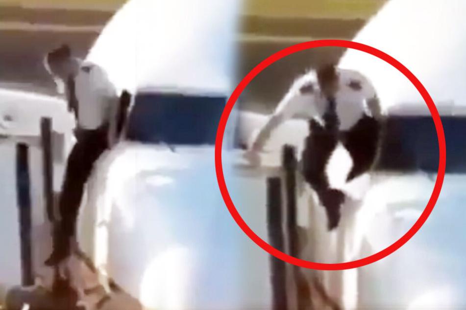 Hier versucht der Pilot auf halsbrecherische Art offenbar eine Reparatur vorzunehmen.