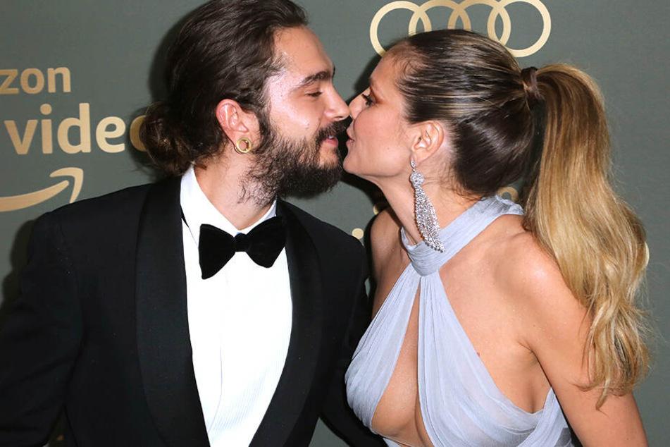 Knutscher! Heidi Klum (rechts) gibt ihrem Tom ein Küsschen.