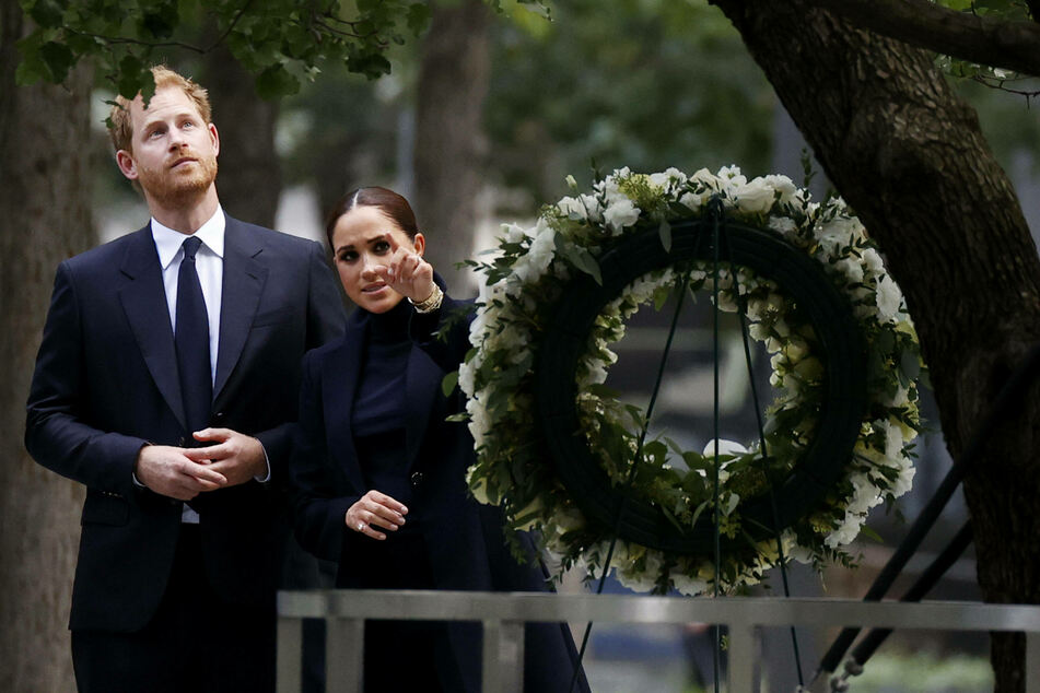 Prince Harry and Meghan stop to view a wreath at the 9/11 Museum at Ground Zero.