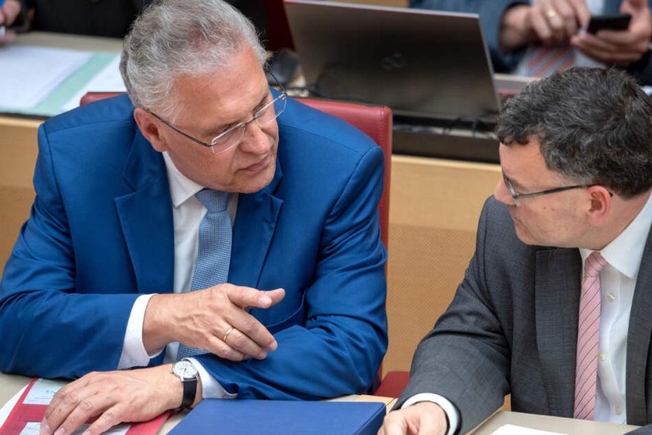 Bayerns Innenminister Joachim Herrmann (l.) sorgt mit seinem Vorstoß für Aufsehen.