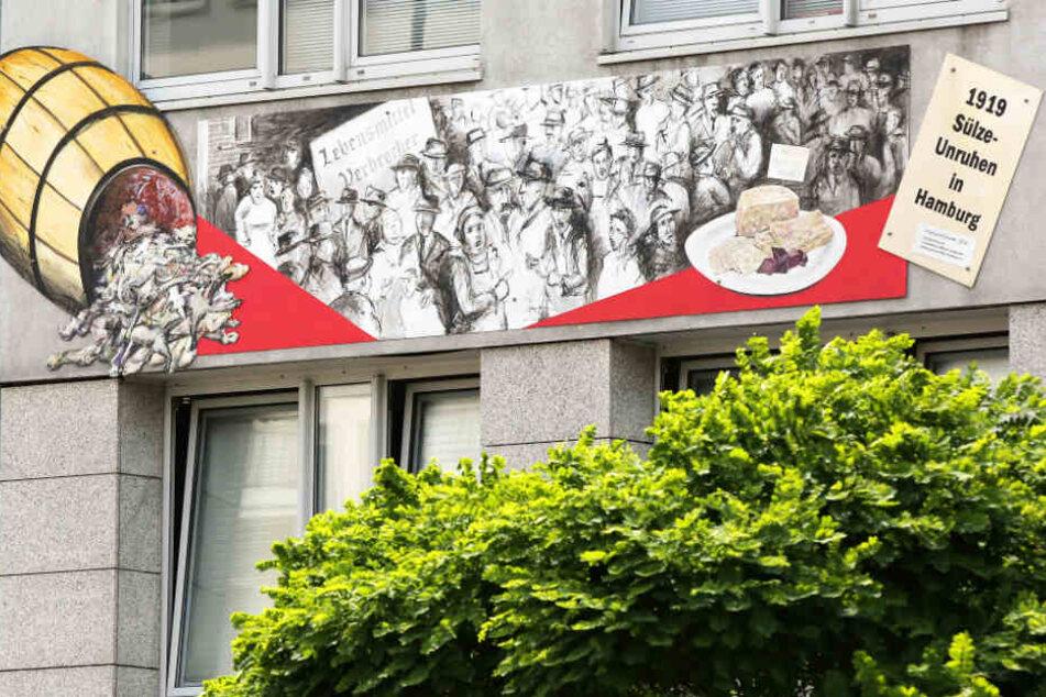 Die Sülze-Unruhen sind in Wandbild am Gebäude der Verbraucherzentrale Hamburg verewigt.