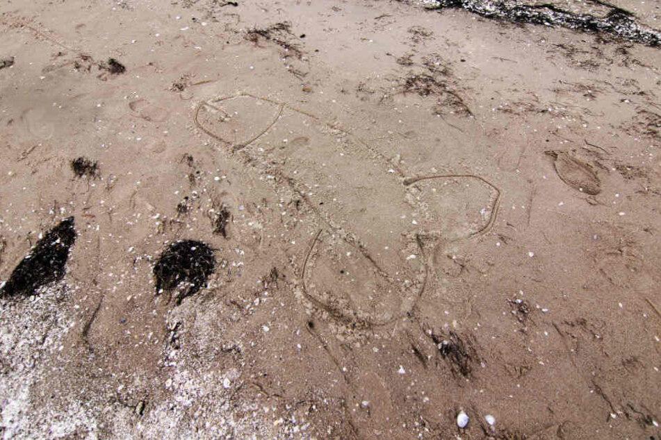 Zeichnungen wie diese am Strand sorgten bei den Nachbarn für Unverständnis. (Symbolbild)