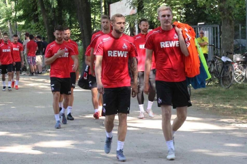 Die FC-Profis Marcel Risse (m) und Frederik Sörensen beim Trainingsauftakt am 4. Juli.