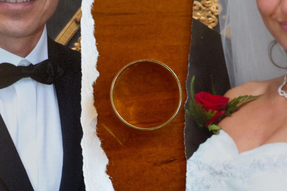 Zerfetztes Hochzeitsfoto mit abgenommenen Ehering. (Symbolfoto)