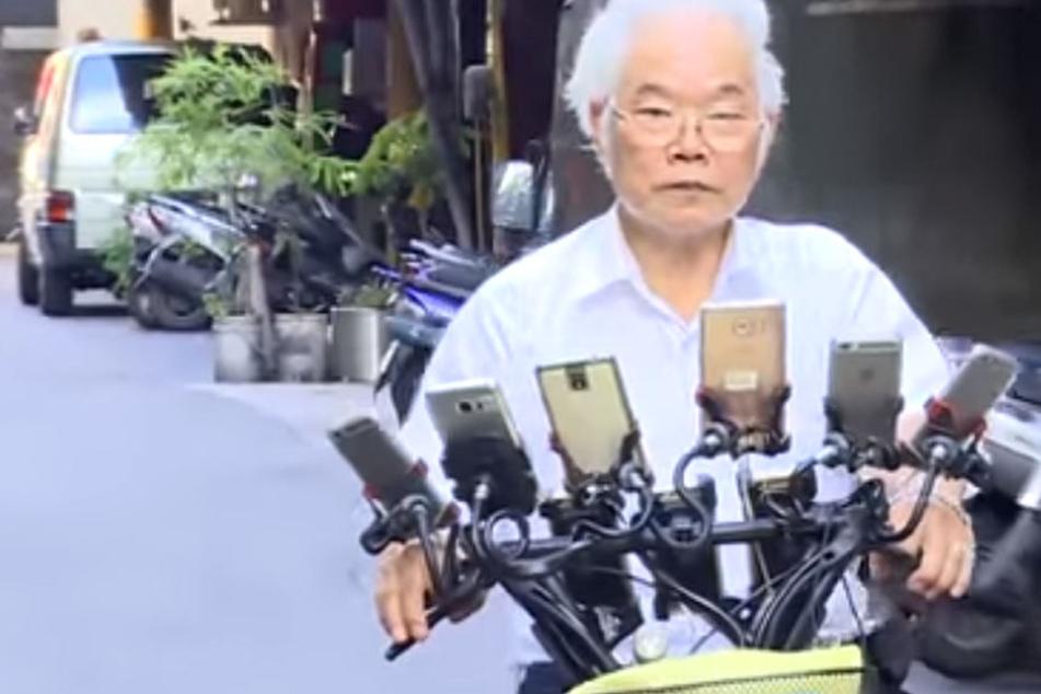 Chen San-yuan (70) und sein Handy-Faharrad sind ein absoluter Hingucker!