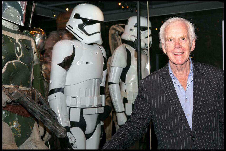 Jeremy Bulloch poses next to his original costume at the 2017 Star Wars Identities: The Exhibition event in London (archive photo).