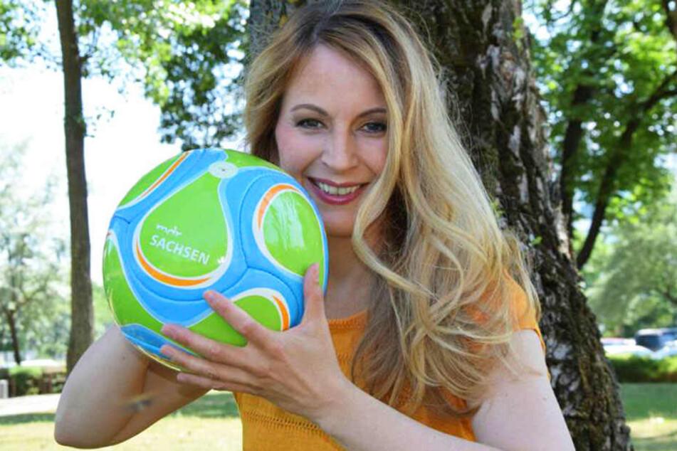 Susanne Langhans unterstützte Jogis Elf 2014 mit Melone. Die Nationalfarben stimmen zwar nicht ganz, dafür ähnelt aber die Form der eines Fußballs.