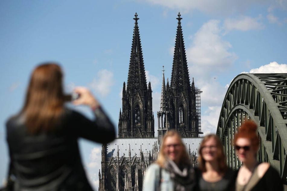 Touristen in Köln.