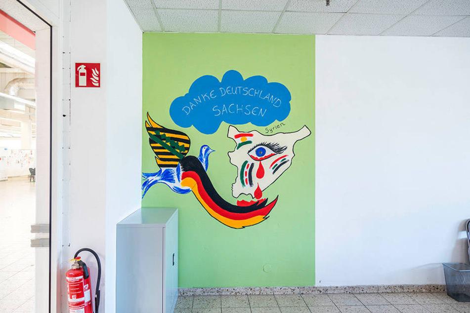 In der verlassenen Erstaufnahme in Niederau sind noch viele Wandbilder zu sehen - gemalt von Flüchtlingen.