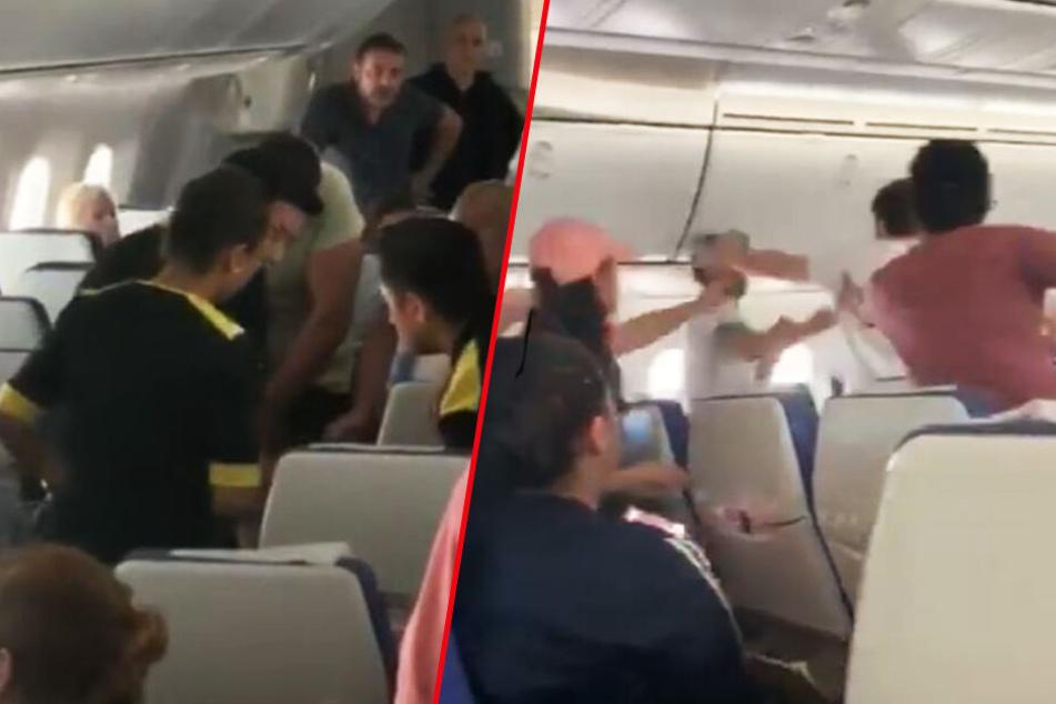 Sitznachbarn prügeln sich im Flugzeug: Die Reaktion des Piloten hat es in sich!