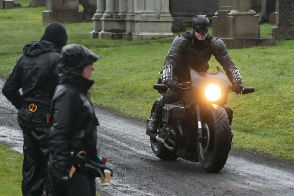 Batman riding his motorcycle through Glasgow Necropolis cemetery during filming.