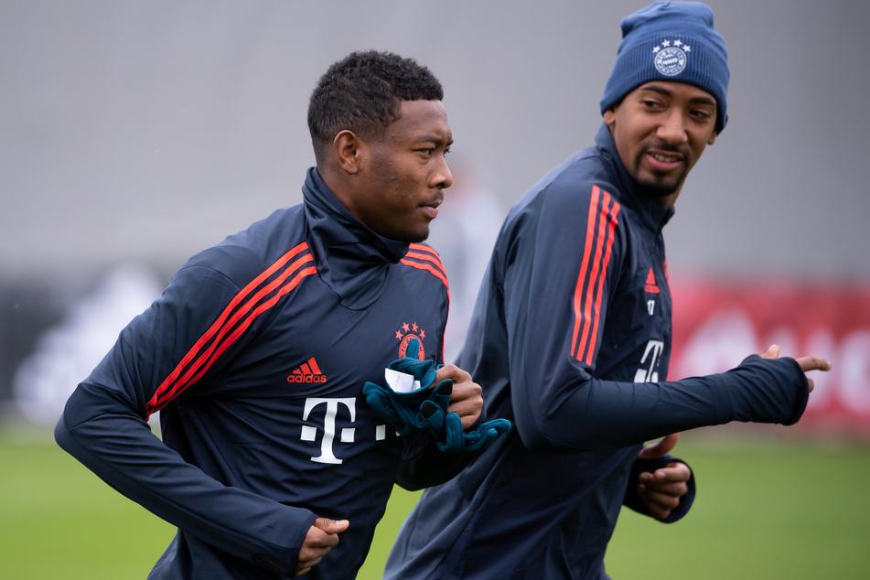 David Alaba (28, l.) und Jérôme Boateng (32) könnten beide nach dem Ende der laufenden Spielzeit den FC Bayern München verlassen.