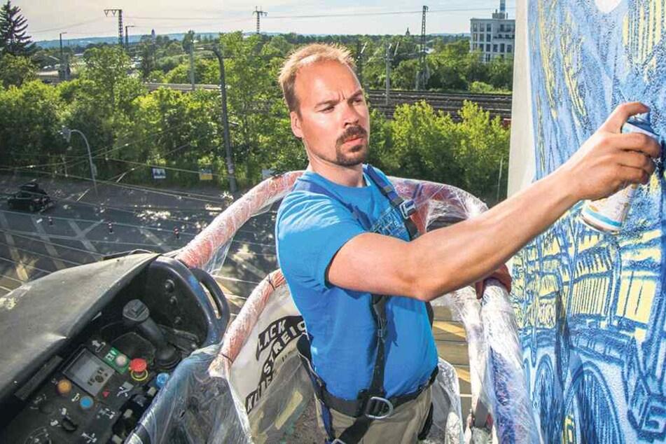 Wo er stoppt, entstehen Graffiti: Wandbildmaler radelt durch Sachsen