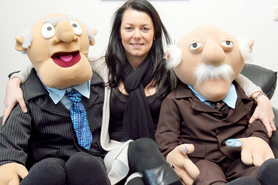 """Das Archivbild aus dem Jahr 2009 zeigt links und rechts die Figuren """"Waldorf & Statler"""", zwei notorische Querulanten aus der Muppet Show."""