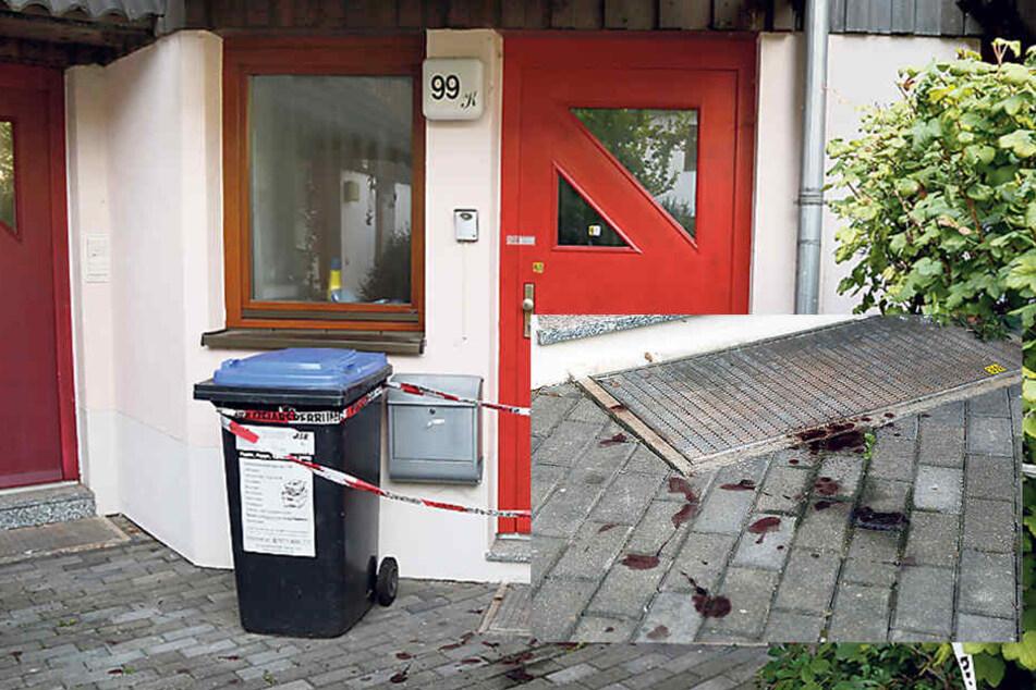 Vor der Haustür der Familie zeugen Blutspuren von dem Drama.