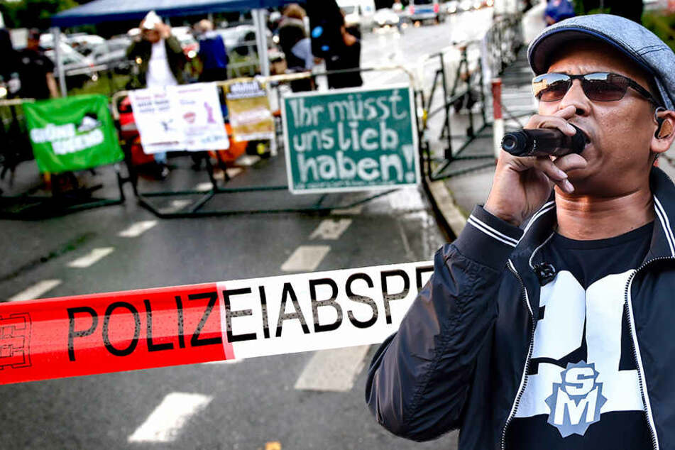 """Nur etwa ein Dutzend Teilnehmer demonstrierte gegen """"Verschwörungstheorien, Homophobie und Antisemitismus""""."""