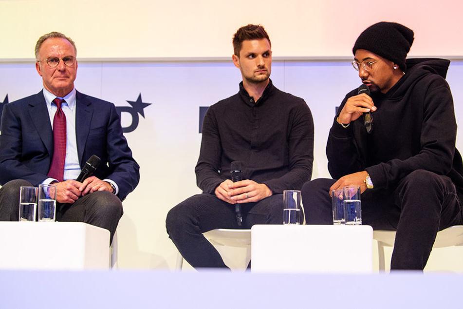 Karl-Heinz Rummenigge (l.) und Jérôme Boateng (r.) sind momentan nicht einer Meinung.