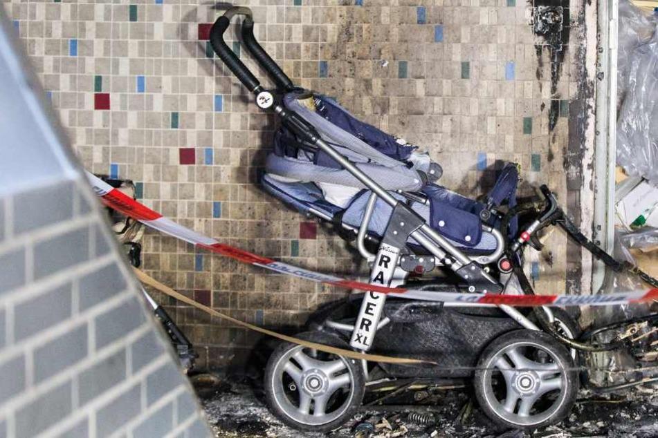 Ein Kinderwagen im Keller des Hauses wurde in Brand gesetzt. (Symbolbild)