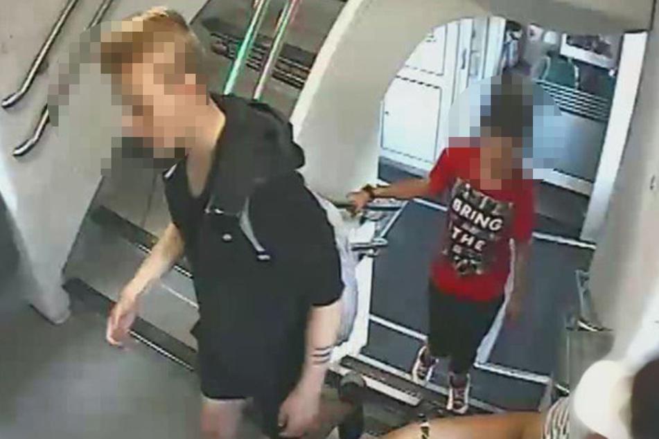 Beide Tatverdächtigen im Zug der Linie RE4 (Bild 1).
