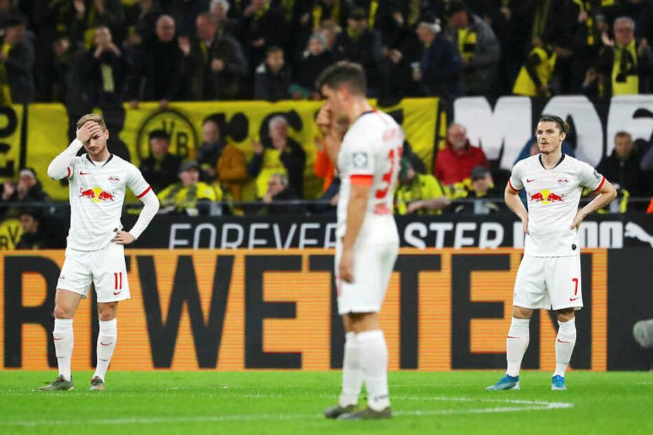 Timo Werner, Diego Demme und Marcel Sabitzer (v.l.n.r.) waren nach dem 0:1 durch Julian Weigl niedergeschlagen.