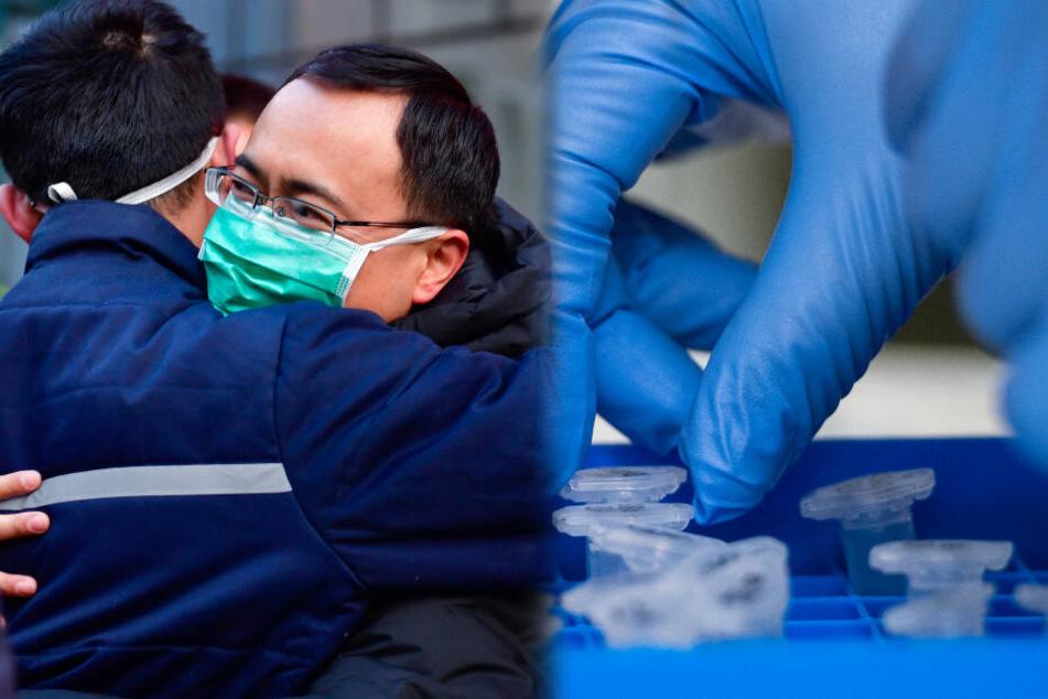 Umarmung eines medizinischen Team, das sich auf dem Weg nach Wuhan befindet (Symbolbild).