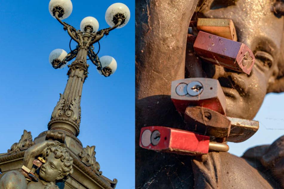 Liebesschlösser hängen an einer Skulptur der Lombardsbrücke.
