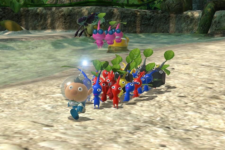 Captain Olimar zusammen mit seiner bunten Pikmin-Truppe auf Tour.