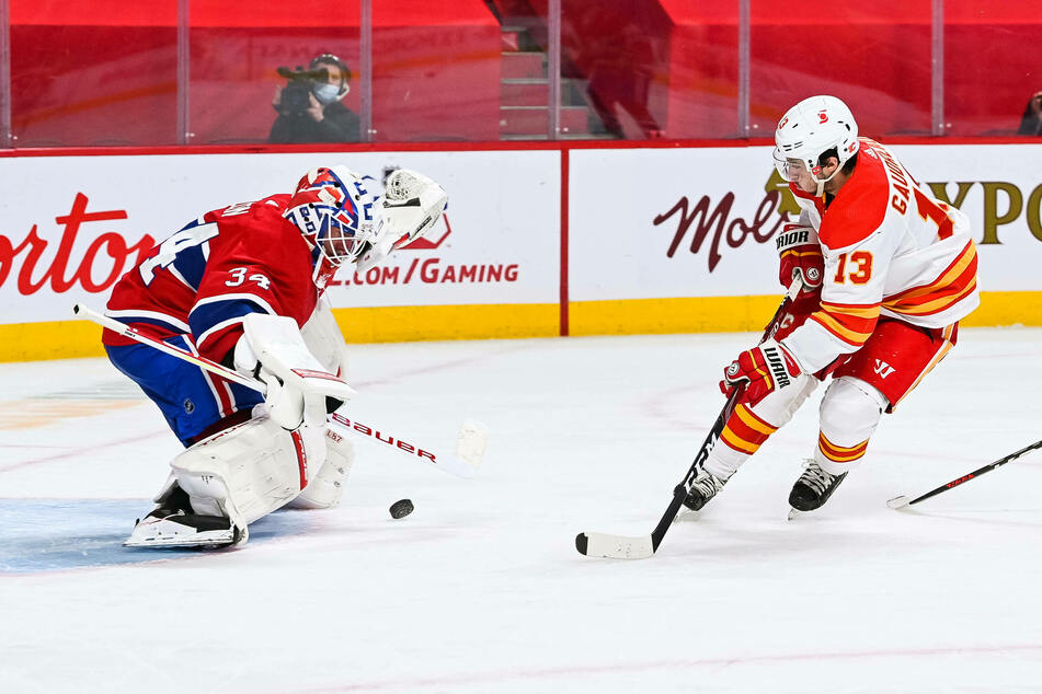 Canadiens goalie Jake Allen makes a save over Calgary Flames left wing Johnny Gaudreau