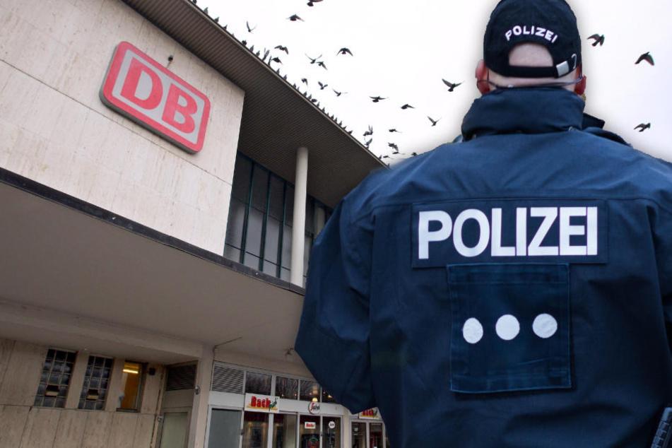 Fotomontage: Passanten machten die Polizei auf den vor dem Hauptbahnhof in Würzburg sitzenden Mann aufmerksam (Symbolbild).