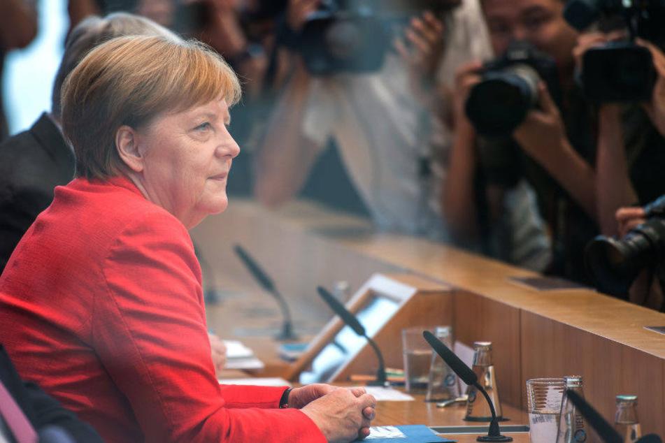 Angela Merkel stellt sich auf der traditionellen Sommer-Pressekonferenz den Fragen der Journalisten.