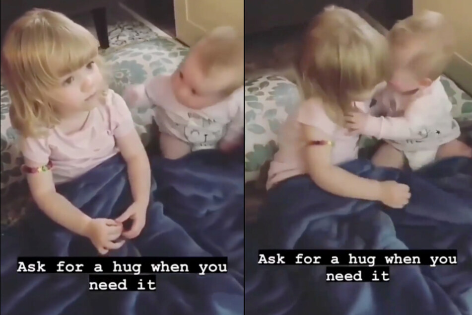 This baby really wanted a hug form her big sister.
