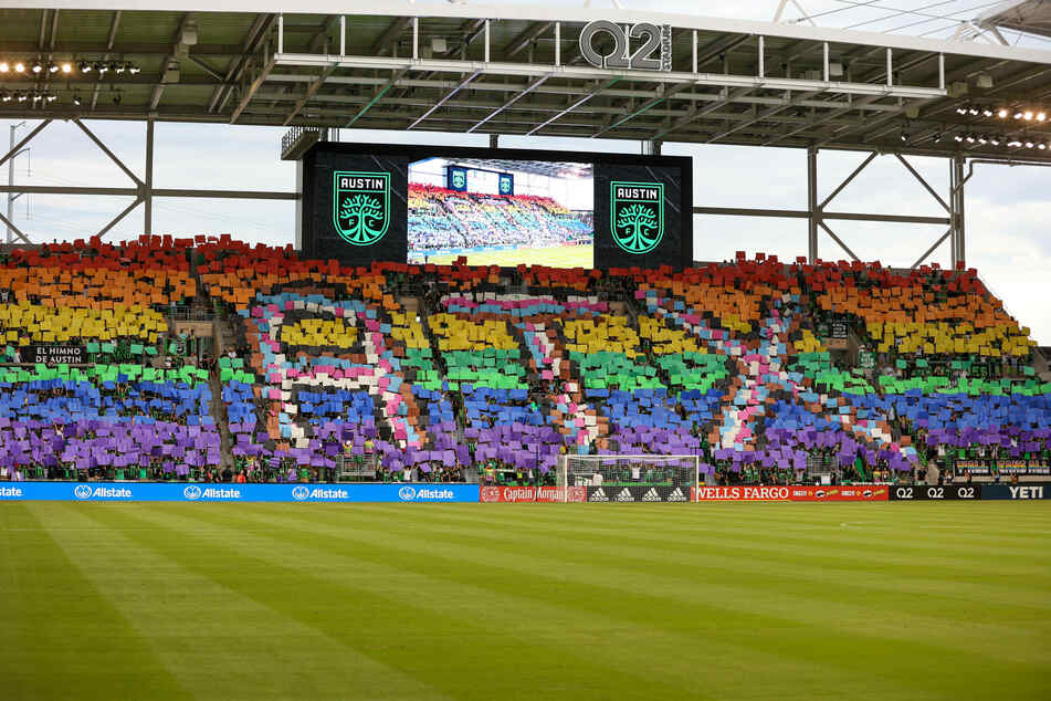 Austin FC supporters hold a rainbow of placards in recognition of Pride Month at Q2 Stadium before a match against Columbus Crew on June 27, 2021.