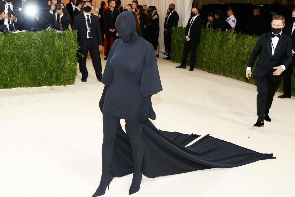 Kim Kardashian rocked a full-body covering, hiding her face with a black mask alongside a matching bodysuit.