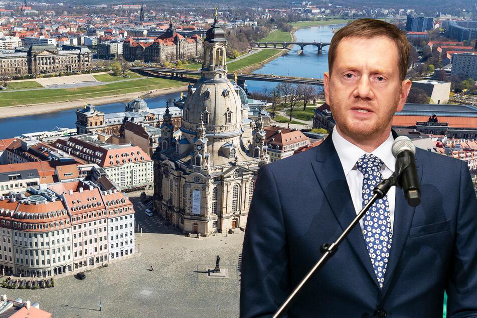 Michael Kretschmer (45, CDU) vor dem Blick in Dresdens Altstadt mit der Frauenkirche und dem nahezu menschenleeren Neumarkt während des ersten Lockdowns Anfang April.