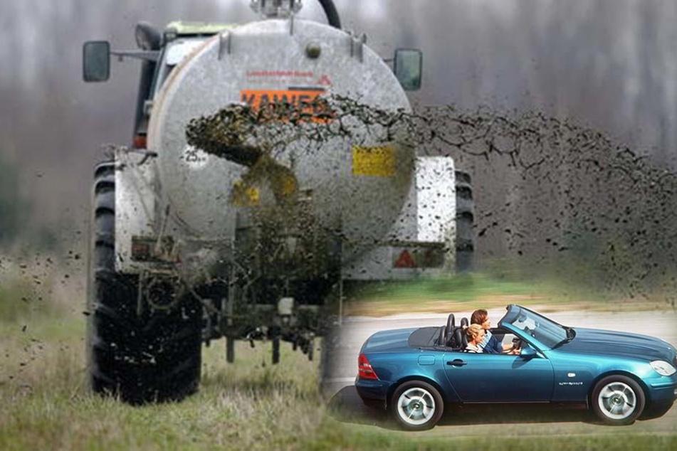Traktor verliert Gülleladung und trifft Vater und Tochter im Cabrio
