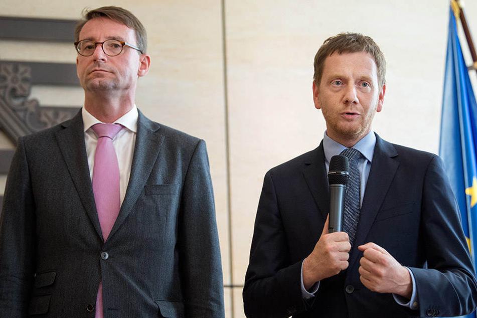 Kommunikative Verwirrung: Ministerpräsident Michael Kretschmer (42, r.) und Innenminister Roland Wöller (47, beide CDU) versuchten gestern ihre Pläne klarzustellen.