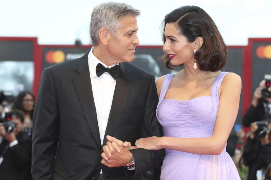 Helfertypen: George Clooney und seine Frau Amal haben einen Flüchtling aus dem Irak in eines ihrer Häuser einziehen lassen.