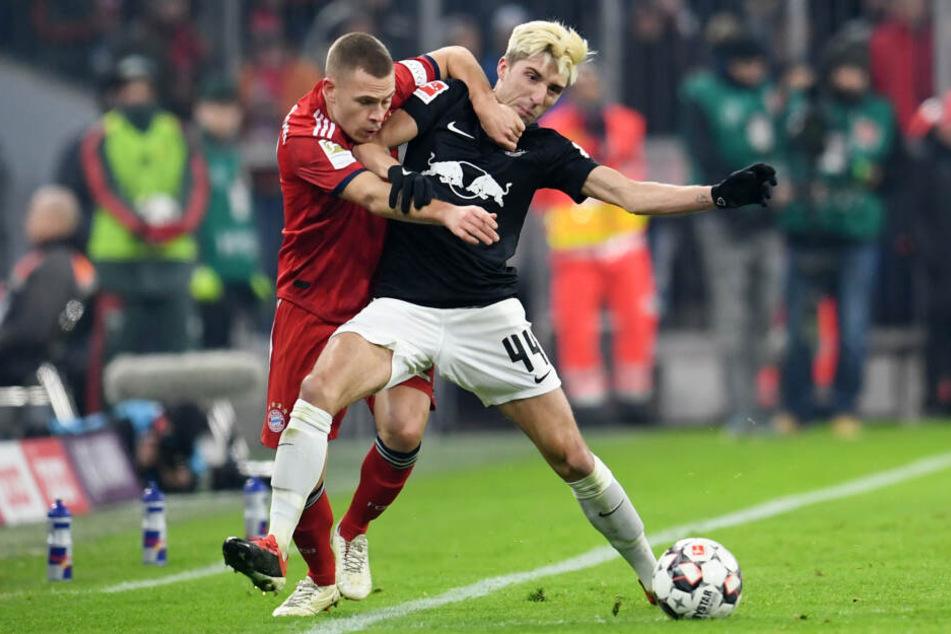 Wird dieses Mal leider nicht dabei sein: RBs Mittelfeldspieler, hier im Zweikampf mit Münchens Joshua Kimmich, der vor seinem Wechsel zu den Bayern ebenfalls in Leipzig spielte.