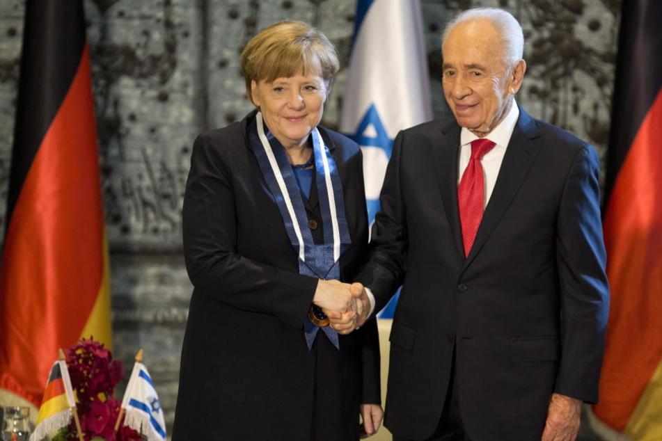 Schimon Peres im Februar 2014 mit Angela Merkel in Jerusalem.