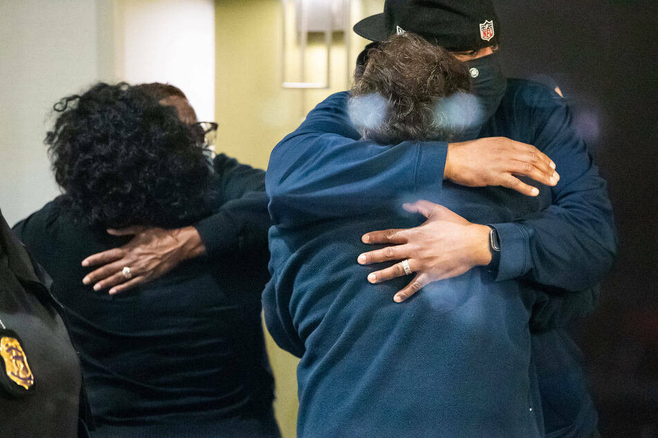 Relatives hug upon learning their loved ones were safe after the FedEx shooting in Indianapolis.