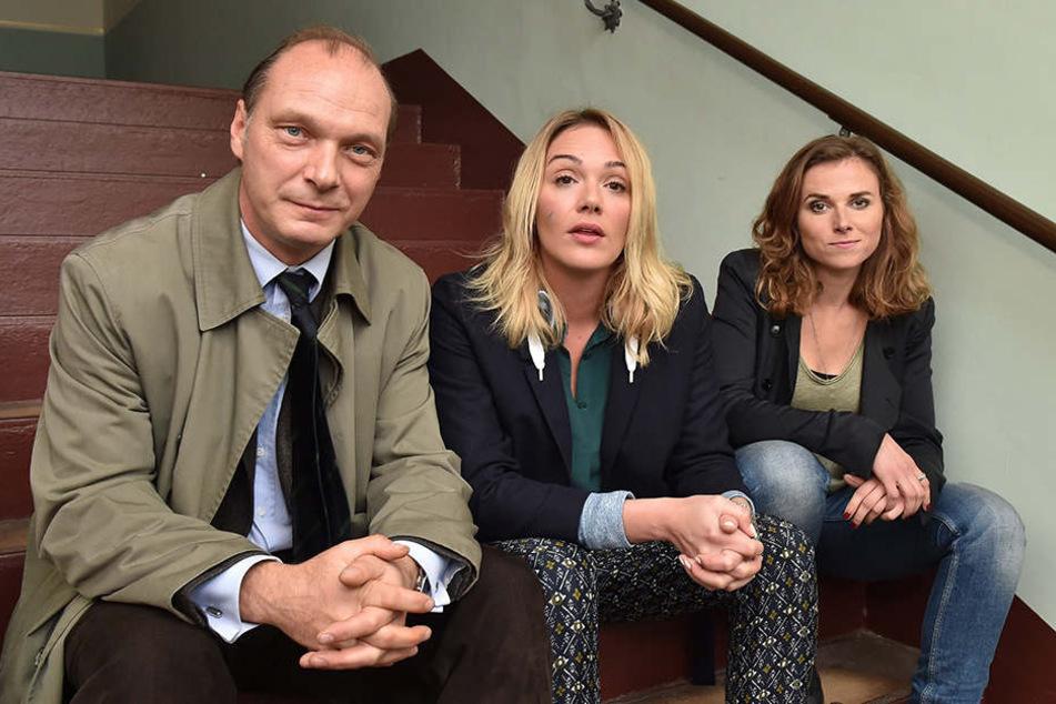 """Sie sind das Dresdner """"Tatort""""-Team. Martin Brambach, Alwara Höfels und Karin Hanczeweski."""