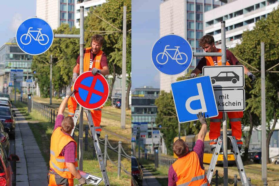 Die Arbeiter montieren die Schilder ab, die das Parken ausgewiesen haben.